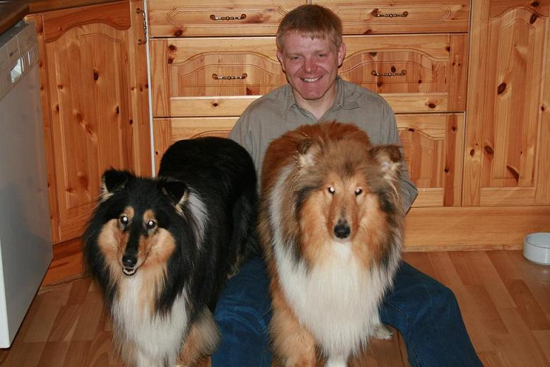 Picture of owner with dogs
